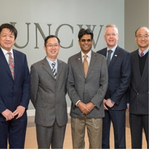 Pictured from left to right: Xin Lu, UNCW Department of Mathematics and Statistics faculty; Wenli He, vice director, Chinese-Foreign Program Management Committee, Chongqing University of Arts and Sciences; Aswani Volety, College of Arts and Sciences dean; Michael Wilhelm, Office of International Programs associate vice chancellor; and Zhuan (John) Ye, UNCW Department of Mathematics and Statistics chair.
