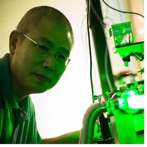 Dr. Yong-Qing Li checks equipment in the lab. (Photo by Cliff Hollis)