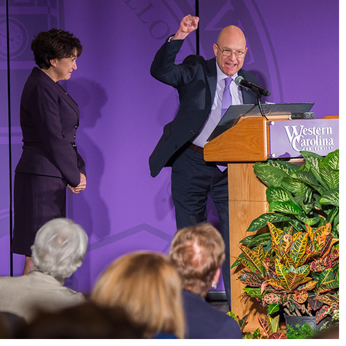Chancellor David O. Belcher and wife Susan Brummell Belcher celebrate with students and donors at an annual scholarship luncheon at which they announced a pledge of $1.23 million as part of the Lead the Way campaign.
