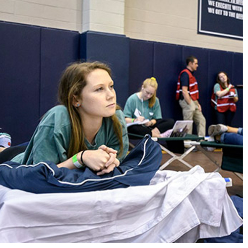 UNCW students participate in the full-scale hurricane evacuation exercise at UNCG's Coleman Practice Gymnasium, which served as the shelter site.