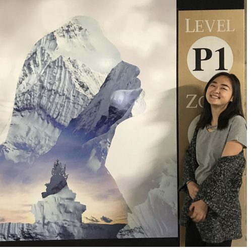 Helen Li '18 poses with her artwork, included as part of an art installation organized by the North Carolina Museum of Art.