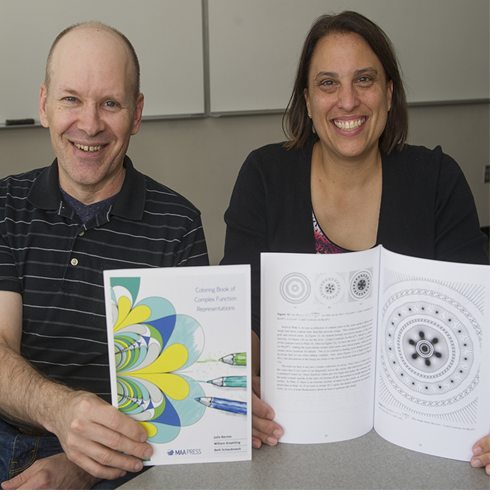"""WCU's Bill Kreahling (left) and Julie Barnes are co-authors of """"Coloring Book of Complex Function Representations,"""" which has become popular on the math circuit."""