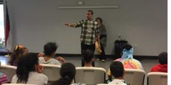 Kaya Littleturtle speaks to local youth during a UNCP event marking the 50th anniversary of TRIO programs