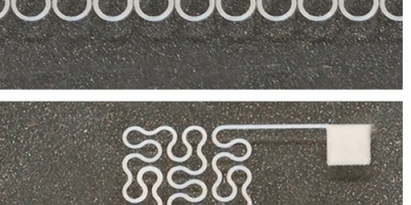 Two printed silver nanowire patterns printed at NCSU, a horseshoe and a Peano curve, with high resolution.