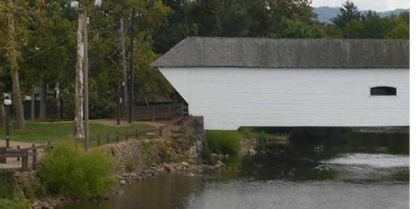 Covered Bridge Park, in downtown Elizabethton, Tennessee, is named for the historic covered bridge that spans the Doe River. The 2.25-acre park includes a small fountain, two pavilions, a gazebo, picnic tables and a large multiuse stage. Photo courtesy of IDEXlab