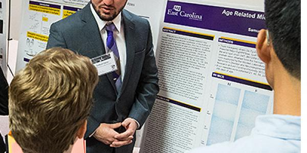 Multidisciplinary neuroscience scholar Samuel Vance showcases his research on age-related Alzheimer's disease during Research and Creative Achievement Week at ECU. (Photos by Cliff Hollis)