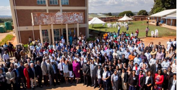 The crowd of staff and guests in front of the newly dedicated UNC Project Annex building (Photo by Jon Gardiner)