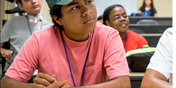 Latino high school students attend a class taught by a UNCG professor.