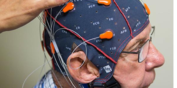 ECU's Dr. Kim administers a test to capture brainwaves testing for Alzheimer's and dementia.