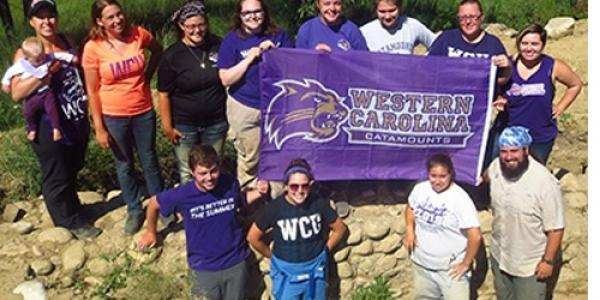 Part of the WCU research team holding flag