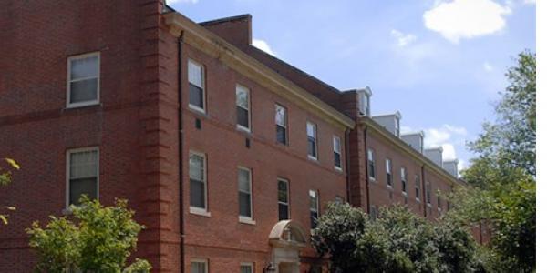 NCSU students walk past Alexander Hall.
