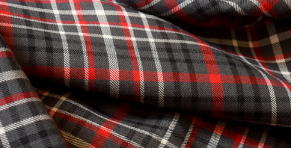 The official NC State tartan was designed by Kelly when she was a graduate student.